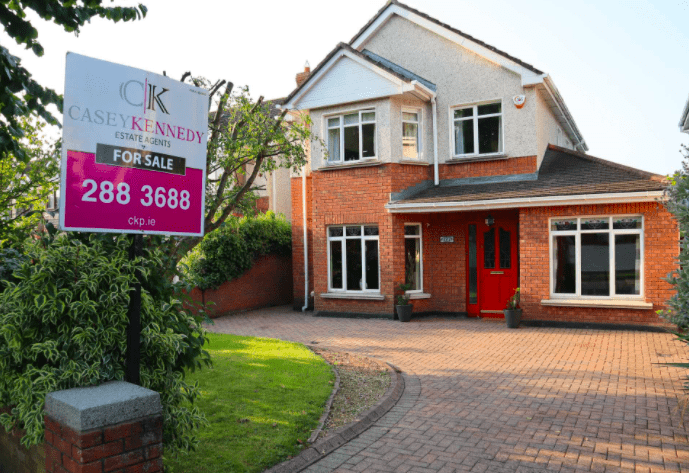 Image of a 2 storey detached house with a Casey Kennedy Auctioneers sign.